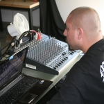 DJ Ace behind the boards